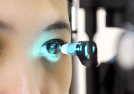 Woman being tested for glaucoma by an ophthalmologist